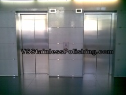 Polishing scratches from stainless steel double lift doors in a resort apartment.
